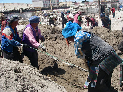 Another Tibetan specialty - women are performing hard work with shovels by helping each other.