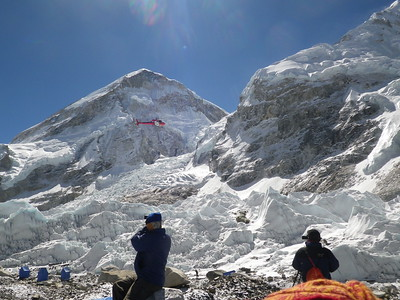 The helicopter is going on a rescue mission above Khumbu icefall.
