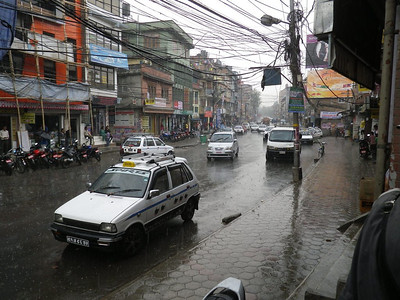 Heavy rain during approach to Budhanath stupa in Kathmandu.