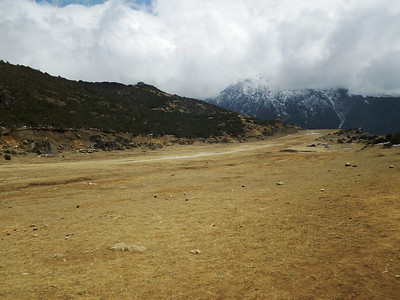 Syangboche airport (12,205ft = 3.720m) can't be used for planes, but it is good for helicopters.