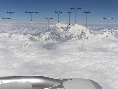 Mount Everest (29,035ft = 8.850m) and surrounding mountains from air.