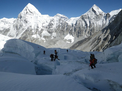 Below C1 approaching Khumbu glacier IceFall on May 21st. On the horizon from the left: Pumori (23,507ft = 7.165m) and Lingtren (22,027ft = 6.714m).