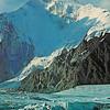 Khan Tengri (7013m) elbowed by Chapayeva, Gorkovo, and Petrovskovo - sheer walls of rock dropping thousands of feet to the glacier.