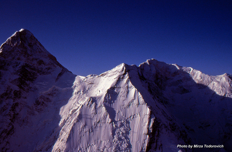 Khan Tengri (el. 22998 ft / 7013 m) was the target of the 1991 expedition in Organization Of Mountaineering Association of Bosnia and Herzegovina and Kiev Climbing Club (Ukraine).<br /> Attractive North Face of the Khan Tengri, more then 2500m tall is left in the image. Right of the center is Peak Chapaev (el. 6371m).