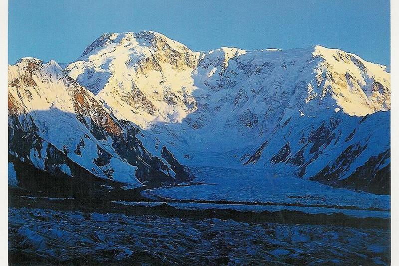 Peak Pobeda's (7439m) massive bulk abouts the Zvyozdochka Glacier with 1.75 miles (3 km) vertical headwall.