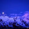 Peak Pobeda still glowing late at night as moon rise over the Kokshal Tau range.