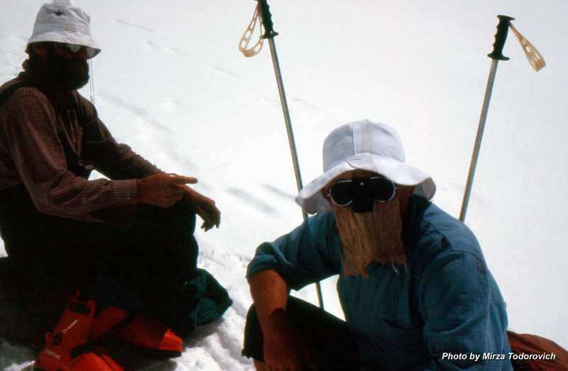 """Hamo and Naim resting half way to Camp 3. The sun reflection is very strong at elevation and we used """"face protectors""""."""