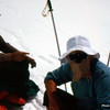 "Hamo and Naim resting half way to Camp 3. The sun reflection is very strong at elevation and we used ""face protectors""."