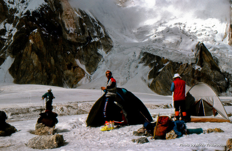 Camp 1 (4100m), after the breakfast, Hamo, Gafa and Naim are getting ready. In the background steep slopes of Peak Khan Tengri (7013m).