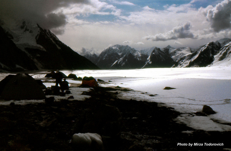 The small patch of stable ground provides place for Camp 1 (4100). We are coming at late evening and some tents are already there. The sound of glacier at this place is pretty loud. You hear running water, cracking the ice and falling the rocks all the time.