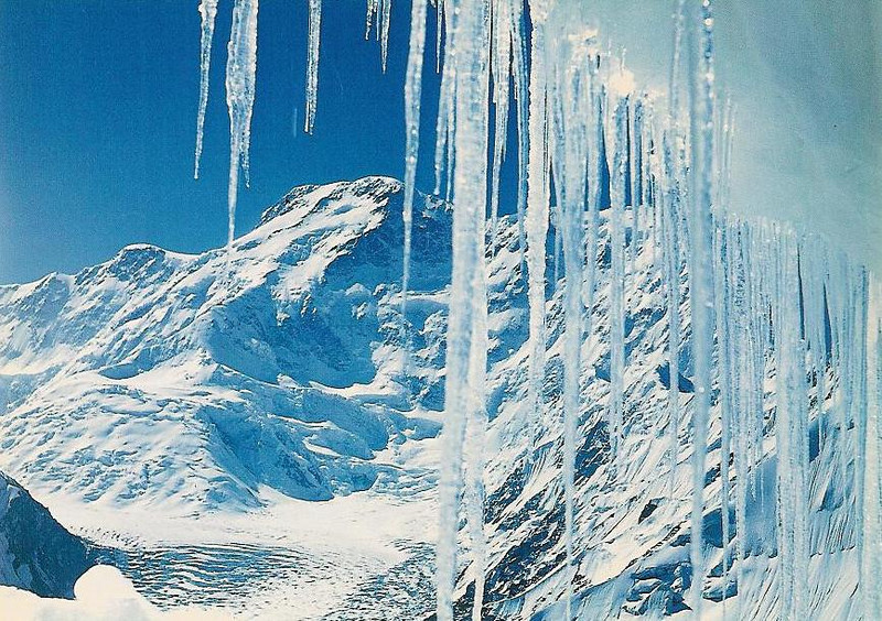 Peak Pobeda (7439m) - view through icicles. Has one of the highhest death tolls of any mountain.