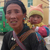 Tibetan mother. Tingri  - Tibet (12,586ft/4.380m).