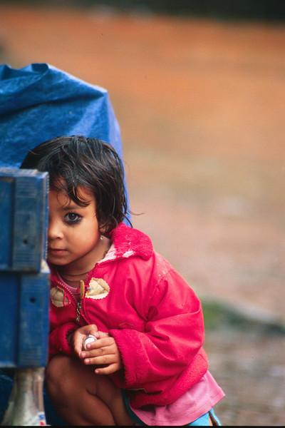 Shy little one. Bhaktapur – Kathmandu, Nepal (4,383ft/1.336m).