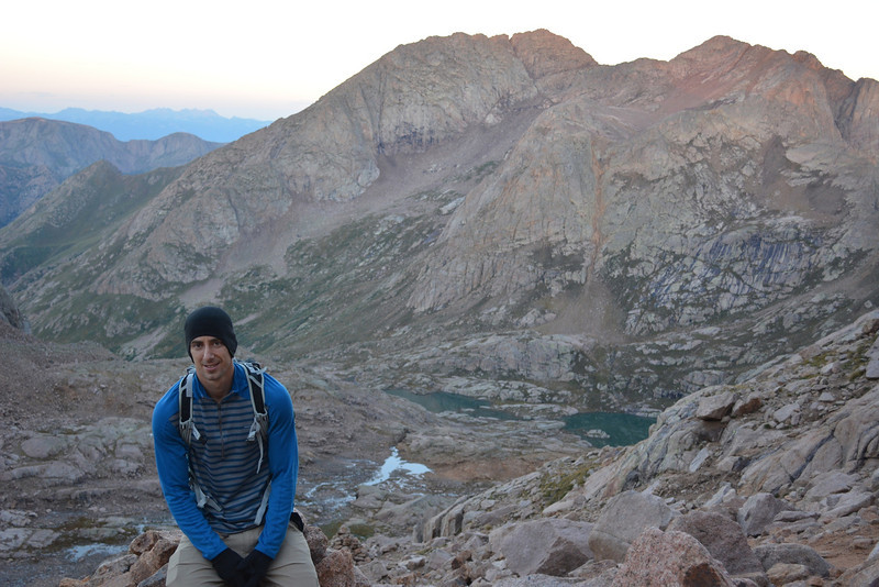 To avoid typical afternoon storms (Be on mountain ridges during lightning is very dangerous!) we started hiking early in the morning: 3:40am.<br /> We used trail over Twin Lakes at 12,500ft or 3.810m visible behind Kenan.<br /> Above Twin Lakes are Mount Eolus (14,083ft = 4.292m) – left and North Eolus (14,039ft = 4.279m) to the right.