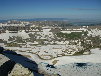 From the saddle between South and Middle Tetons: Icefloe Lake below is still frozen - mid August???