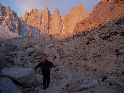 Early light on the trail toward Iceberg Lake. Needles and Mt. Whitney in the alpenglow. On the left Pinnacle Ridge.