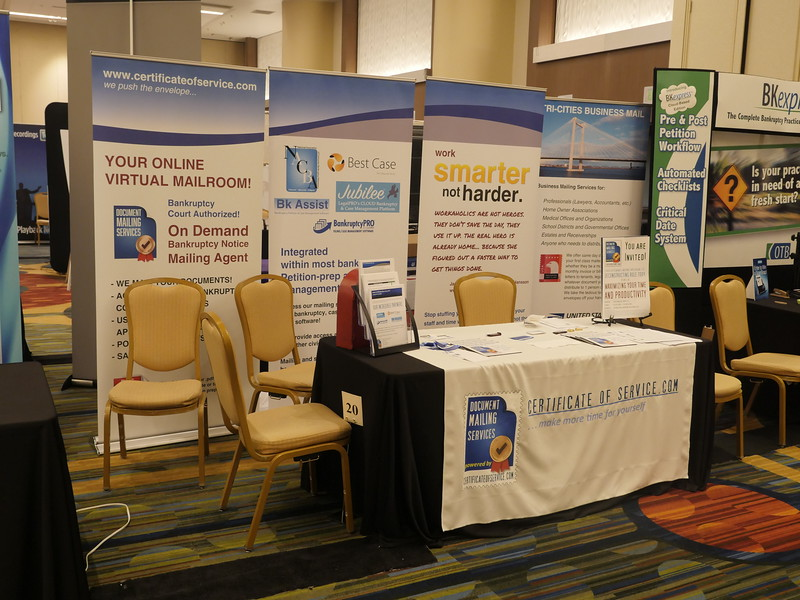 Exhibitor booths and sponsor banners during Saturday sessions