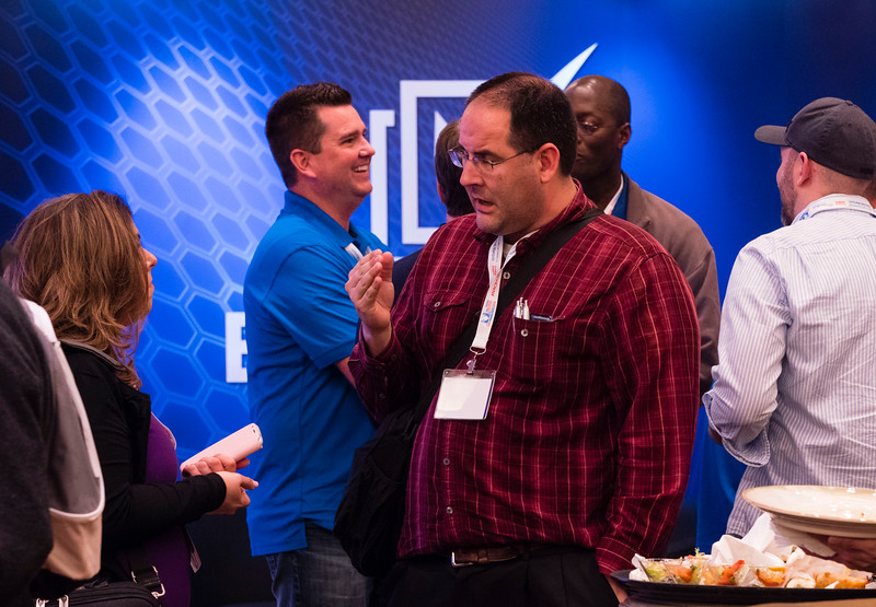 Speakers and attendees during Convention reception at Friday sessions