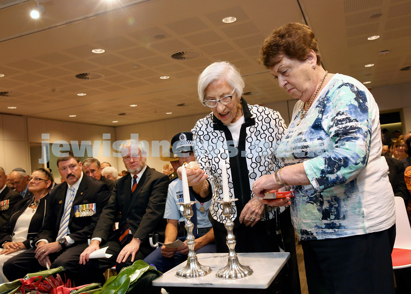 NAJEX ANZAC Day Ceremony at The SJM. Yvonne Abadee & Pat Robey light Memorial Candles. Pic Noel Kessel.