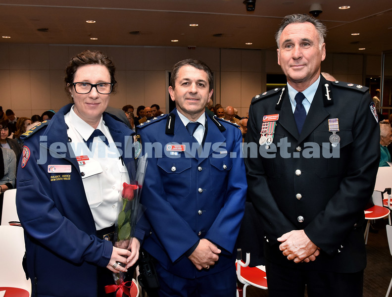 NAJEX Communal Wreath Laying and Remembrance Day Service at SJM. From left: NSW Ambulance Inspector Kerrie Simpson, NSW Police Inspector David Vidal, NSWFR Supt. Norman Buckley. Pic Noel Kessel