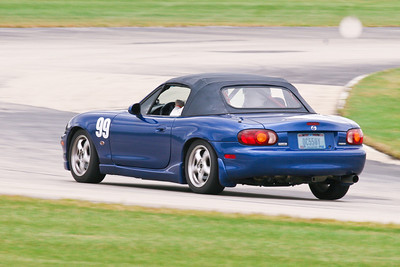 Tedd Reichenbach and his beautiful supercharged HPDE Miata in action during NASA Midwest-Great Lakes Regions Crossover weekend at Autobahn Country Club, September 2010