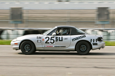 Jason Pulvermach and his NASA Midwest Region Spec Miata in action on the road course and banked turns at GIR, April 2010