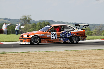 Korey Deason and his NASA German Touring Series (GTS3)  BMW M3 (orange #571) racing through the Keyhole at Mid-Ohio Sports Car Course, July 2010
