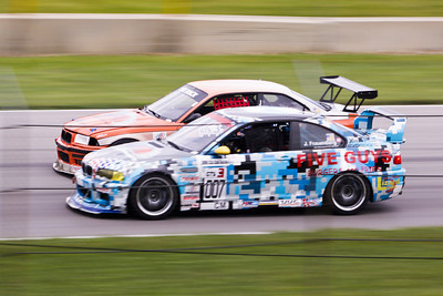 Korey Deason (orange #571) and Jamie Frauenberg (#007) raced like this all weekend  splitting the GTS3 wins during NASA Great Lakes Region racing action at Mid-Ohio Sports Car Course, July 2010