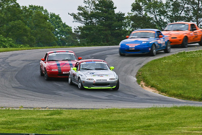 Justin Hille (175), Jon Lawrence (red07), Team Tedlar (blue 47), and Chris Williams (55) battle through the off-camber Turn 3 during furious NASA Great Lakes Spec Miata action at Grattan Raceway, June 2011.