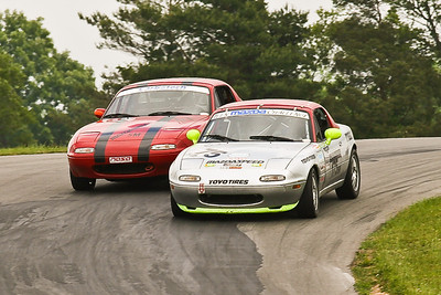 Justin Hille (175) and Jon Lawrence (07) battle through the off-camber Turn 3 during NASA Great Lakes Spec Miata action at Grattan Raceway, June 2011