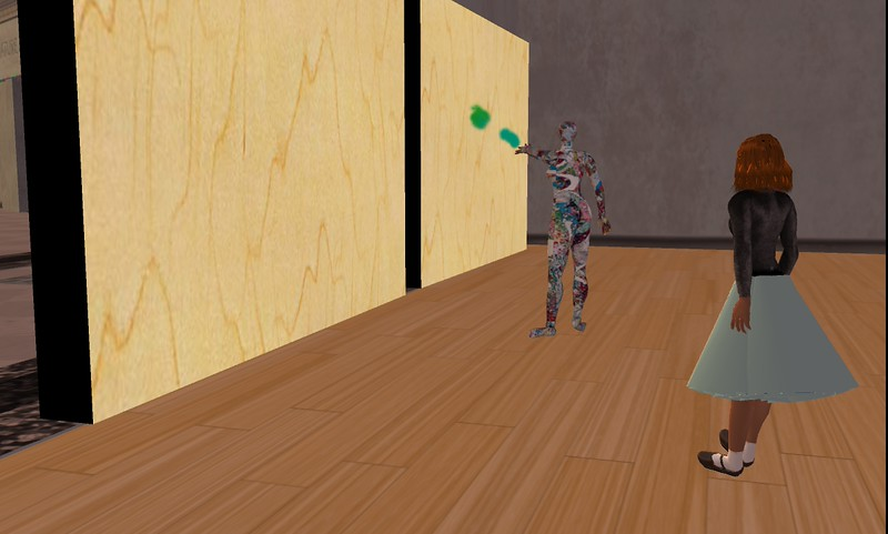 Kristine Schomaker begins to assemble her show, A Comfortable Skin, in the ANSIBLE virtual world gallery space.