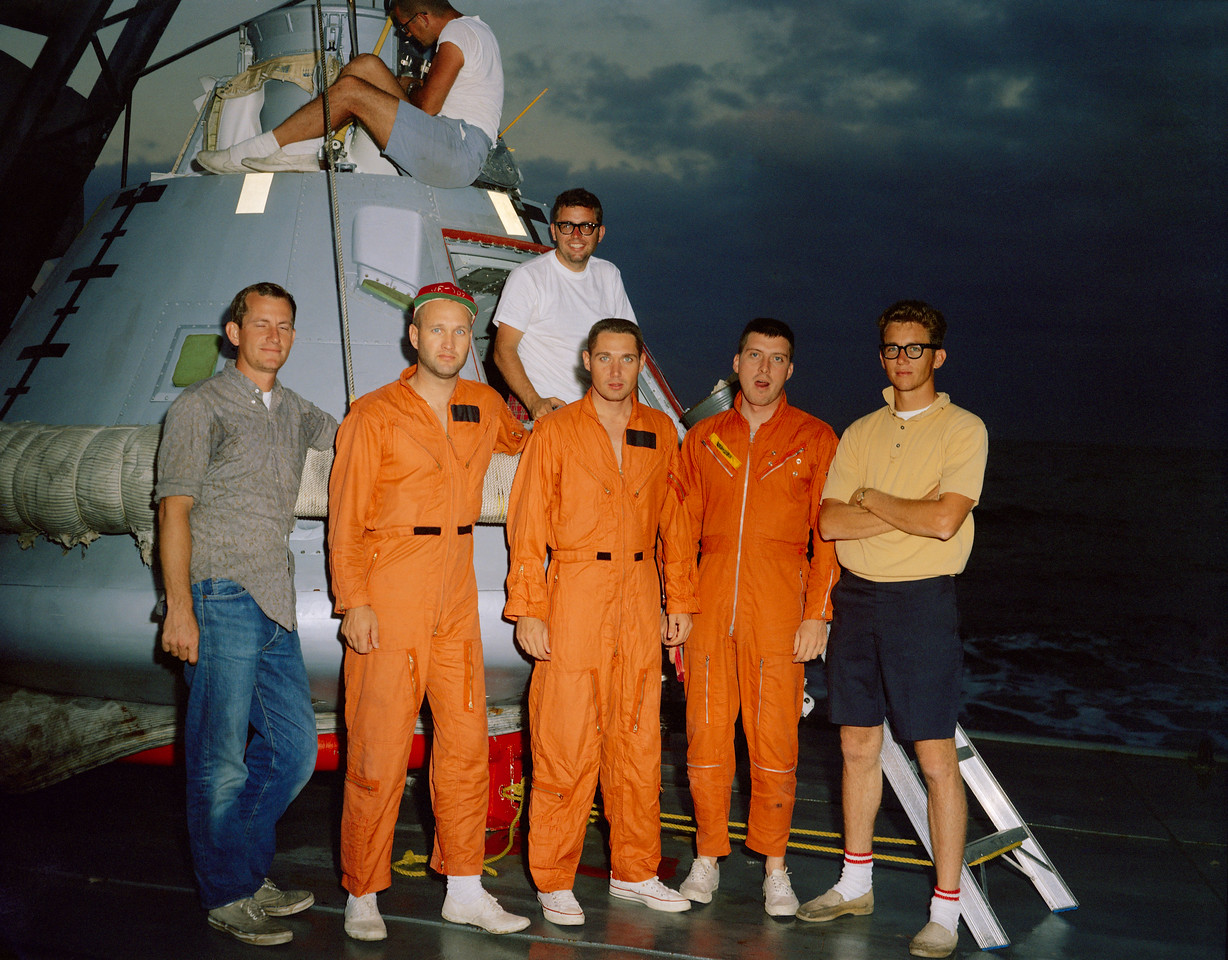 taken aboard the M/V <br /> Retriever in the Gulf…with Jim Shannon and S/C007 (used for manned <br /> post-landing tests) is Tex Ward, Lou DeWolf (both from Crew Systems I <br /> believe), and Harry Clancy (all three test subjects), Larry Bell, Mac <br /> Jones in the hatch and Tech Services mechanic Lamar Beatty (I believe) <br /> on 007's upper deck…Jim Shannon and Larry were the test conductors for a <br /> 48-hour manned test in October of 1966…Mac was the S/C007 vehicle <br /> engineer…