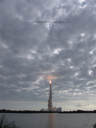Endeavour about to punch through the cloud cover.  -- May 16, 2011