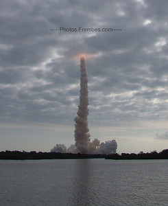 Endeavour disappears through the clouds.  -- May 16, 2011