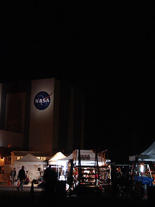 Early morning on launch day - May 16, 2011. Press tents set up with the VAB in the background.