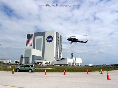 Heading out to the press site parking lot, we spot a chopper landing on the helipad in front of the VAB. -- May 16, 2011