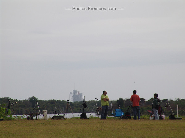 #NASAtweetup day 2 - Another fave photo: Photographers in the foreground and Endeavour in the background.  -- April 29, 2011