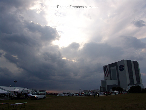 #NASAtweetup day 1 - Storm clouds converge on the VAB. Lightning is seen dispersed in the clouds. -- April 28, 2011