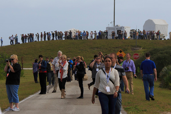 The press and pros are assembled on the hill to shoot the rollout.