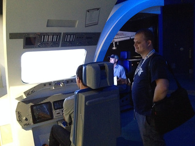 """Adam Holt is on stick at the shuttle landing simulator, while Logan Gallaway provides the """"Top Gun"""" soundtrack."""