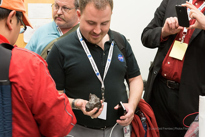 Jason Townsend of NASA HQ social media holding the iron meteorite. I think we all had that look of wonderment when it was our turn to hold it.