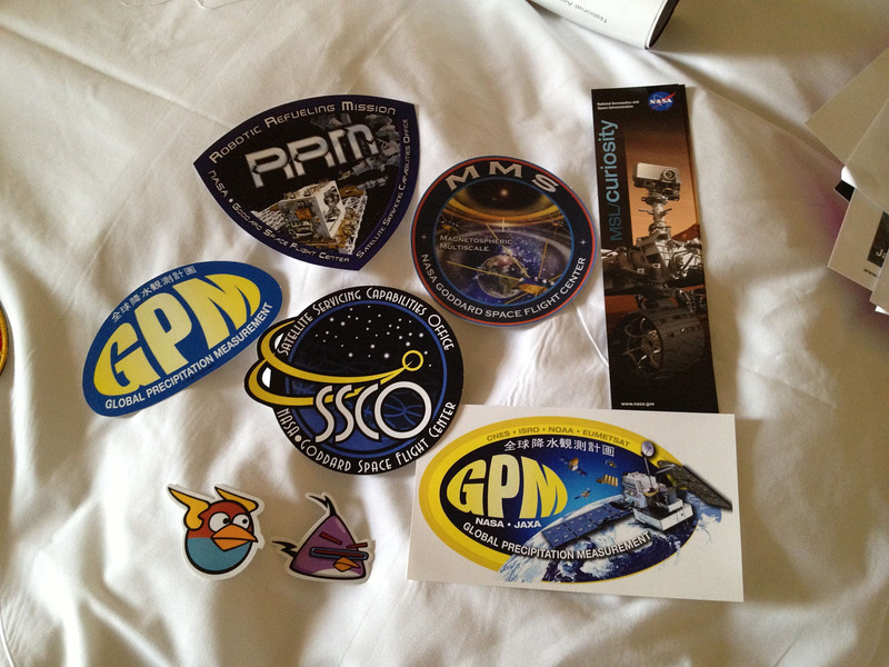 NASA nerd swag, including two Angry Birds stickers.