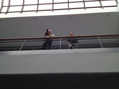 iPhone photo of NASA photographer Pat Izzo (left) and Jason Townsend, NASA HQ social media, taking the group photo from above.