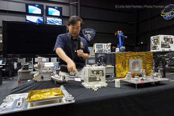 Dr. Edward Cheung explains the Robotic Refueling Mission in Goddard Building 27N.