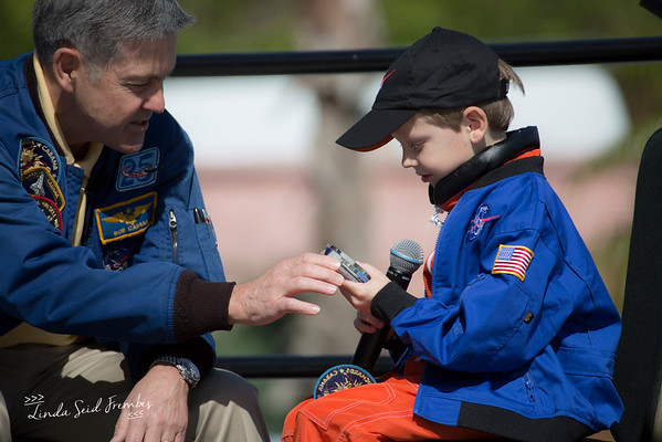Kennedy Space Center director and former astronaut Bob Cabana gives a commemorative bolt that flew on the ISS to Connor Johnson.