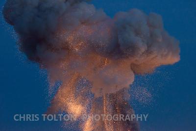 Sparks descend near the launch site