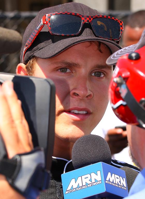 Trevor Bayne surrounded by media post crash Talladega