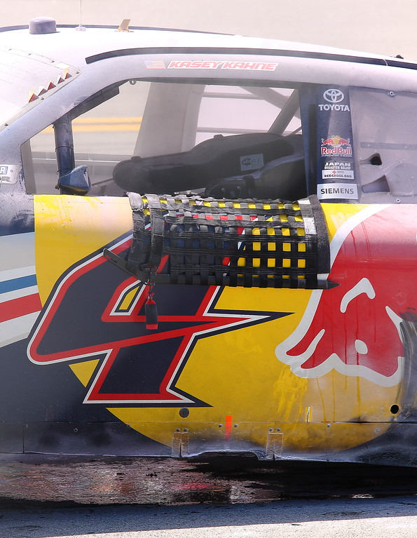 Kasey Kahne's Red Bull No 4 as the smoke clears on the track at Talladega
