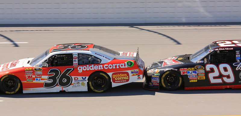 Kevin Harvick in the No. 29 Budweiser pushes No 36 Golden Corral David Blaney at Talladega