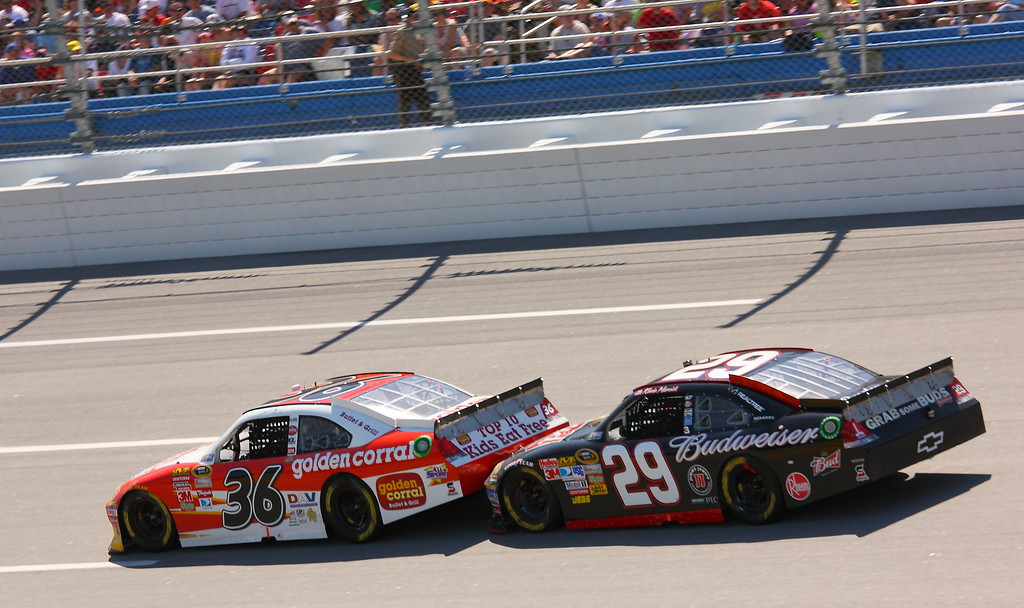 Dave Blaney and Kevin Harvick nose to tail Talladega